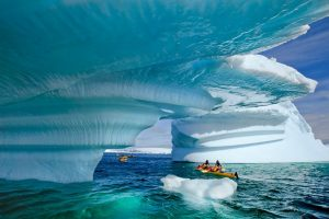 Canoeing through Ice blocks in Antartica
