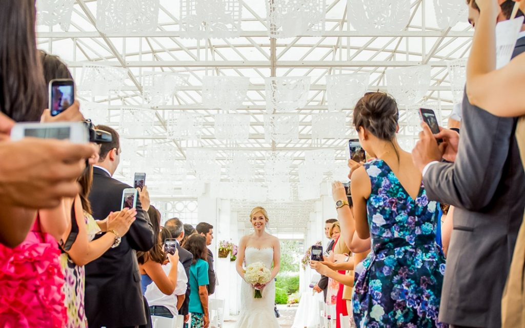 Wedding Guests taking photos on their phones