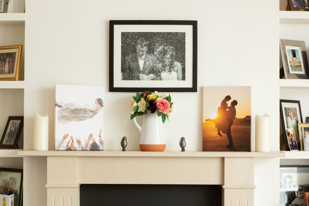 Picture and posters on a Mantlepiece