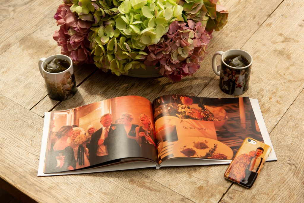 Photo Book on a table with mugs and flowers