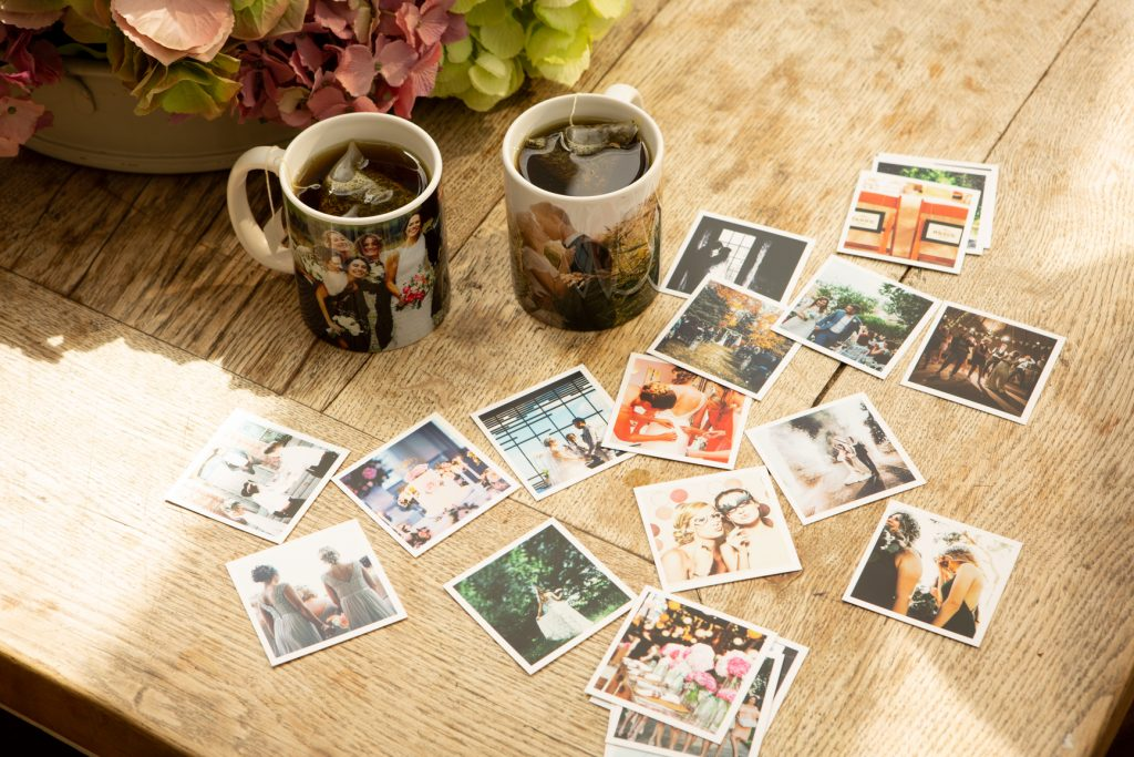 Prints and mugs on a table